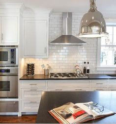 stainless steel kitchen range hood - chimney range hood -- this might a good option, gives us the hood/venting we need without a lot of bulk to block light from the window on the left.
