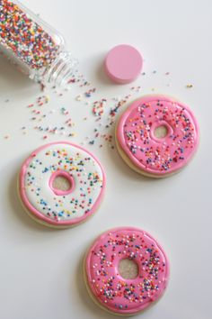 Check out the list of adorable desserts like these sugar cookie pink sprinkle donuts. The rainbow sprinkles and frosting are perfect for a baby shower or girl birthday party. Use as party favors or on the sweets table to add decoration and a pop of color!