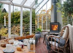 I november dricker vi te i växthuset framför den tända elden i braskaminen. Porches, Orangerie Extension, Cool Shower Curtains, Timber House, Summer Landscape, Backyard, Patio, Outdoor Living, Outdoor Decor