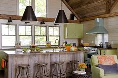 Rustic kitchen with a modern feel. Rustic kitchen with a modern feel. Rustic kitchen with rustic wood ceiling and plank island with modern elements. Rustic Lake Houses, Rustic Cabins, Lakefront Homes, New England Homes, Stylish Kitchen, Kitchen Cabinetry, Kitchen Wood, House And Home Magazine, Luxury Interior Design