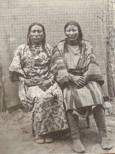 A photograph of the Crow two-spirit Osh-Tisch (on the left), also named Finds-Them-And-Kills-Them, also called Woman Jim, with a woman who is probably the one named in the story, The-Other-Magpie.