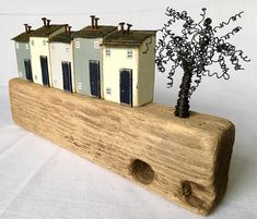 This wooden art comprises little houses made from reclaimed wood which are set on a lovely Driftwood base. This would make a lovely gift for Mum or Dad or any lover of recycled art. Five little houses are hand painted in chalk paint and given scorched and corrugated tin rooftops. Rusty