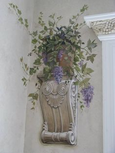 Bring life to your walls by putting a plant on your sconce.