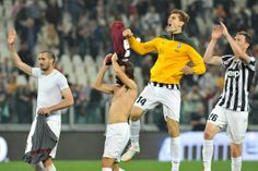 Fernando Lorente (2nd R) of Juventus celebrates victory at the end of the Serie A match between Juventus and AS Livorno Calcio at Juventus A...