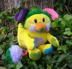 This is Pineapple Pop, a plush doll made from an official vintage 1980s Popples pattern. She is one of a kind, and I will NOT be making another like her again. She is made from super soft minky fabric and fleece, with faux fur hair and other details. Her plastic safety eyes are vintage as well