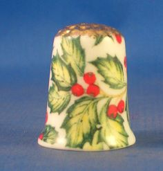 FINE PORCELAIN  CHINA THIMBLE HOLLY AND BERRIES GOLD TOP.