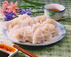 chinese dumplings also known as jiaozi, were traditionally served during the new year in northern china and parts of southern china. they symbolize wealth because of their shape, which resembles the ancient chinese gold and silver. they can be made with a variety of meats and vegetables.