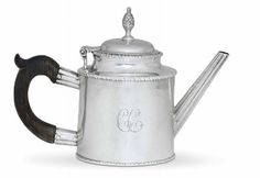 A RARE SILVER TEA POT  MARK OF PAUL REVERE JR., BOSTON, CIRCA 1782  Drum form, with gadrooned borders, with fluted straight spout and scroll wood handle, the slightly domed hinged cover with gadrooned border and surmounted by a cast bud finial, the body engraved on one side with monogram CC, marked twice under base with Kane mark B, also with scratch weight 16 oz.-14, with modern fitted wood case  9 1/8 in. (22.8 cm) long over spout; 6 1/2 in. (16.3 cm.) high; 16 oz. 10 dwt. (520 gr.) gross tea time, silver teapot, rever teapot, antiqu silver, tea pot, silver servic, paul rever, precious silver, americana week