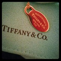 ~ Tiffany & Co. 18k Gold Oval Tag Necklace ~ Authentic purchased from Tiffany & Co. In Seattle.  18 k gold, 16 inch 18 k gold chain. Return To Tiffany Collection.  Comes with authentic Tiffany pouch and box. Barely worn, excellent condition.  Vintage, no longer in production. Please feel free to make reasonable offers and ask questions   *No Trades* *No Low Ball Offers* Tiffany & Co. Jewelry Necklaces