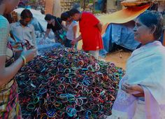 Bangles all the way...  Women are selecting bangles in a public market.   Stalls selling bangles and doing a roaring business without any season is a top shopping list of every girl and women, especially in India.   ' We prefer living in color'.