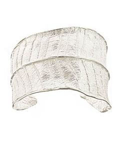 Catherine Weitzman Plumeria Leaf Silver Cuff  Catherine Weitzman's plumeria leaf silver cuff reproduces stunning details in magnificent sterling silver, for a glam, nature goddess look anytime you want it. The oversize cuff is two inches at its widest point, with an open closure that ensures a perfect fit.     Metal: Sterling silver  Width: 2 inches  Length: 6 1/4 inches