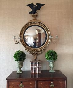 Beautiful mirror frame with Modern Masters Metallic Paint | Gorgeous Interior Design by Jordan S. Vaughn and Alayna Louise Interiors.