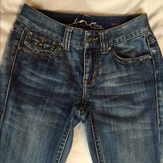 INC Jeans Bootcut short length from INC. Rhinestone detail and awesome fade. Size 0 petite  INC International Concepts Jeans