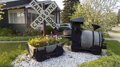 Wine Barrel Planter with Rail Road Crossing Sign