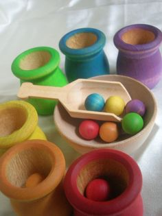 Montessori Toy Rainbow Matching and Sorting Game in a Tin Box -  Wooden Ball, Scoop and Cups Play Set for Boys and Girls. $24.50, via Etsy.