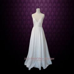 Elegant ivory taffeta slim A-line floor length wedding dress. Perfect if you want a simple and clean design wedding dress.    SKU: Christy Y131205 Working