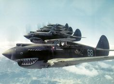 World War II P-40 Warhawk Pursuit Fighter planes from the Flying Tigers Squadron in China. The real deal.