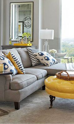 Making a colour statement doesn't mean the colours have to be overwhelming or super in-your-face. It can be through details and touches; yellow is given a lovely voice in this pale grey room.
