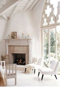 Gorgeous windows, exposed beams in the steepled ceiling, and carved marble above the fireplace.