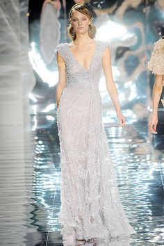 I love the asymmetrical lines in this gown! plus it has lots of bling!