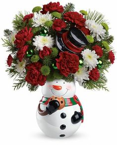 Teleflora's Snowman Cookie Jar Bouquet - #Christmas #flowers in a ceramic resuable snowman cookie jar with lid.