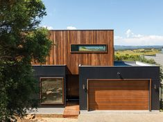 Warm timber accents are contrasted with charcoal Scyon cladding to put a modern spin on a rustic look. An amazing project by that speaks beautifully to it's rural surroundings. Click the bookmark tab below to save the look! House Cladding, Timber Cladding, Exterior Cladding, Facade House, Cladding Ideas, Modern Exterior, Exterior Design, Timber House, Australian Homes