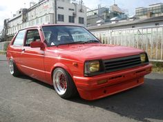 Starlet in a fiery Red Orange on color matched SSR Starsharks. Ae86, Toyota Starlet, Nissan, Toyota Cars, Sweet Cars, Jdm Cars, Car Manufacturers, Custom Cars, Old School