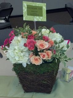 Spring luncheon moss and twig basket by Fleur de Vie.