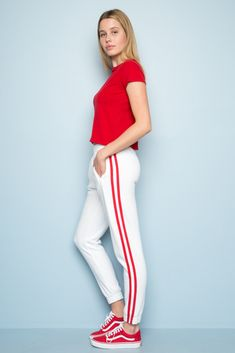 Super soft fleece fabric sweatpants in white in white with red stripe side detailing, side pockets and elastic cuffs. Model is wearing size S. Sweatpants Outfit, Lazy Outfits, Red Stripes, Fleece Fabric, Brandy Melville, What To Wear, Model, Felicia, Clothes