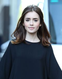 LILY COLLINS Age: 26  Profession: Actress and model  Lily's father is the man, the myth, the legend, Mr. Phil Collins. In other words, she had major league shoes to fill. Thus far, she's doing okay with it. She majored in broadcast journalism at USC and is a successful model, having appeared in numerous publications and named the International Model of the Year in 2008 by Glamour Magazine.