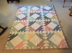 Quilt made by Sharon Theriault from pattern on Red Geraniums website.  Twirling Triangles