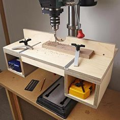 Instantly up your hole-making accuracy and convenience with this built-in-a-day attachment. This table features a top surface big enough to support large workpieces, an easy-to-adjust fence for repeatable accuracy, quick-action hold-downs, and accessory storage.Featured in WOOD Issue 242, October 2016