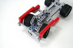 A type of steering system that allows for tight wheel wells. roughly studs wide between the inner wheel tips. Lego Technic, Lego Mindstorms, Lego Nxt, Lego Creative, Lego Truck, Lego Pictures, Lego Construction, Lego Military, Cool Lego Creations