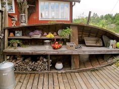 Recycle an old row boat into garden/backyard storage and work space (@ Go Nautical)