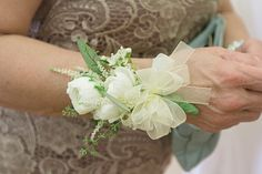 Wrist corsage - White ranunculus, astilbe, waxflower & seeded eucalyptus - http://www.ashlittle.com/ | Flickr - Photo Sharing!