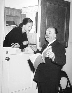 Alfred Hitchcock discusses a scene with Alida Valli during the filming of The Paradine Case in London, 1947