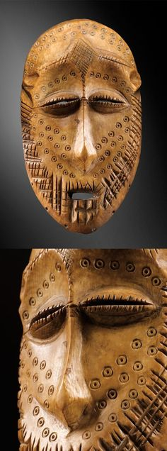 Africa | Large mask (idimu group) from the Lega people of DR Congo | Ivory; cream to reddish brown patina. H: 18 cm | ca. 1930