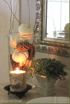 White Pumpkins & Pine cones With A Wood Candle