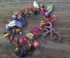 Hey, I found this really awesome (but really over priced) Etsy listing at https://www.etsy.com/listing/184126438/jewelrybracelet-browning-buck-charm