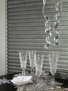 Add a metallic shine to the New Year with Alustra® Duette® Myst™ honeycomb shades.  ♦ Hunter Douglas window treatments #Entertaining #PartyDecor