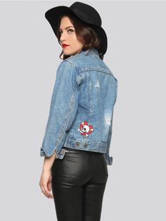 VINTAGE Classic Levi's denim jacket, cut in a short boxy fit, and features a Gypsy Warrior patch above the upper pocket, and a skull and crossbones patch on the back. Completed with a button up front, and allover holes and slits that give off a grungy, distressed finish. Sold as is.