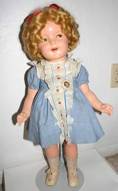 """25"""" compo Shirley Temple doll from 1936. A great doll with golden mohair wig and clear eyes, she is wearing a very rare embroidered cherry dress."""