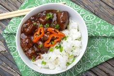 Spicy Asian Venison Bowl - venison stew meat with generous amount of delicious spicy sweet asian sauce over a bed of scallion rice.