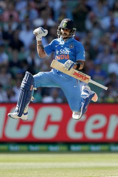 Virat Kohli of India celebrates his century during game three of the One Day International Series between Australia and India at Melbourne Cricket Ground on January 17, 2016 in Melbourne, Australia. (Jan. 16, 2016 - Source: Darrian Traynor/Getty Images AsiaPac)