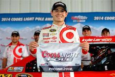 Kyle Larson, driver of the #42 Target Chevrolet, poses with the Coors Light Pole Award after qualifying for the NASCAR Sprint Cup Series GoB... Kyle Larson Becomes First NASCAR Drive for Diversity Graduate to Win Sprint Cup Series Pole | Fan4Racing  http://fan4racing.com/2014/08/02/kyle-larson-becomes-first-nascar-drive-for-diversity-graduate-to-win-sprint-cup-series-pole/