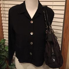 Black Blouse Gorgeous blouse with neat shell like type buttons. Made in U.S.A. 55% acetate 45% rayon. Has padded shoulders. Super cute with a Cami underneath. Excellent Condition  CLIO PETITES Tops Blouses