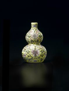 Fine Chinese Miniature Famille Rose Double Gourd Vase, Six character Jiaqing mark and of the period (1796-1820). Dimensions: (Height) 7.5 cm (3 in.). Provenance: Allan Gibson Hughes (d.1938), of Chalfont, The Mount, Shrewsbury. Photo courtesy Woolley & Wallis, Salisbury, Wiltshire.