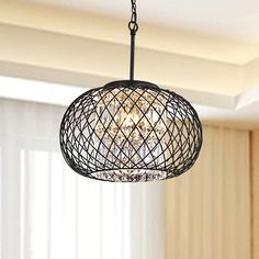 Add a vintage style look with a contemporary twist to your home with this elegant iron pendant with crystal accents. This round light fixture is sure to add style and illuminate any room. Features: An