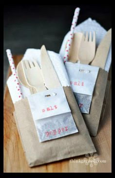 These cutlery pockets are the perfect solution to having too many things to carry as your load your plate up with goodies. You can make these with a simple brown paper lunch sack. Just cut the tops off the bags (use a patterned scissor for a fun effect) so that the cutlery can be seen. Staple salt and pepper packets to the front. Then stuff with a folded napkin, straw, and silverware.