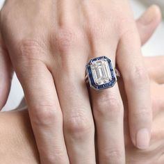 Daydreaming about this Vintage signed Oscar Heyman piece. A gorgeous platinum 8.39ct emerald cut diamond with a sapphire halo. How dreamy! See more at: abrandtandson.com